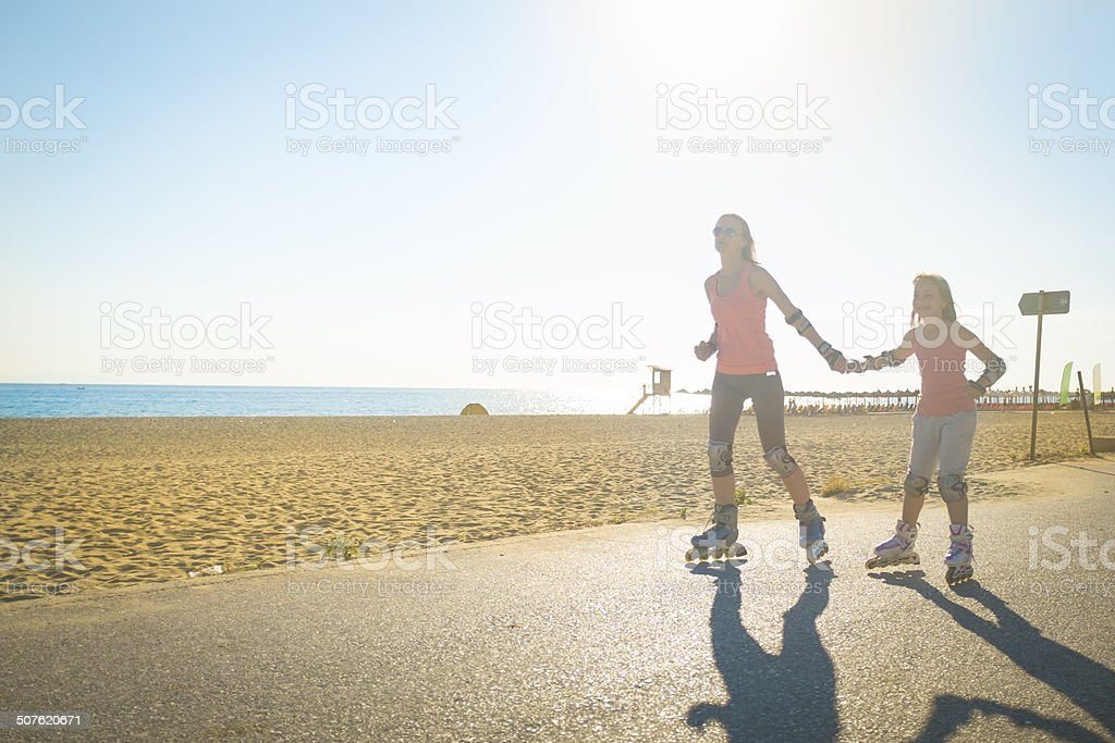 Rollerblading at the beach stock photo