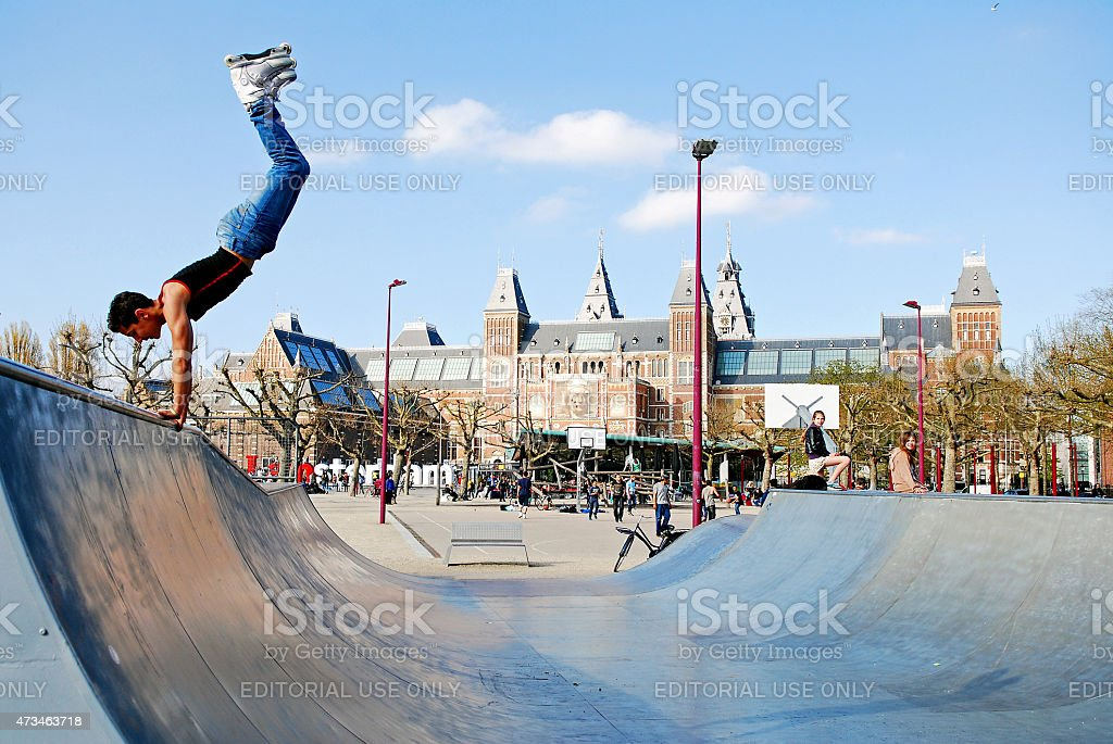 Rollerblading with acrobatics at the skatepark stock photo