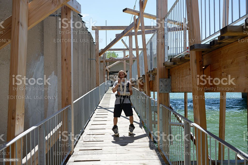 Rollerblading with broken arm in Lyon, France stock photo