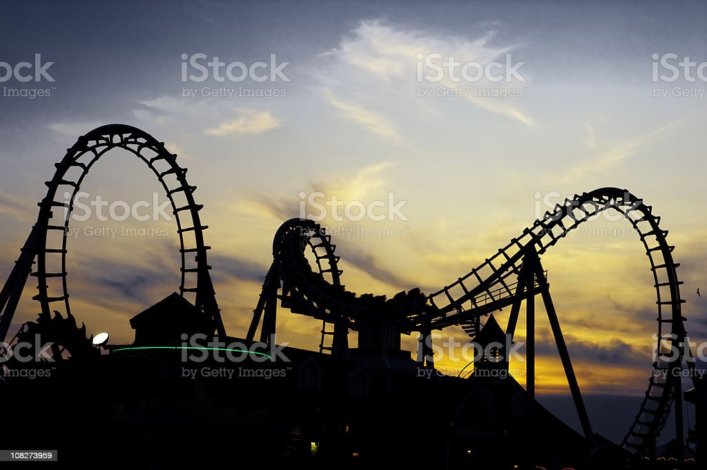 rollercoaster in the sunset stock photo