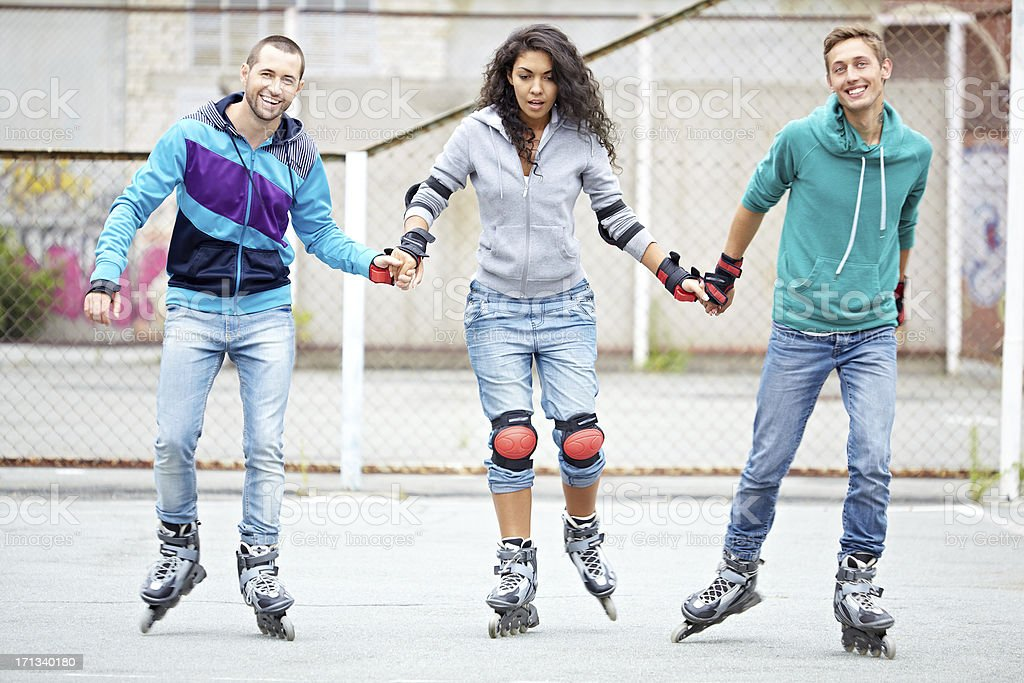 Rollers skating friends royalty-free stock photo
