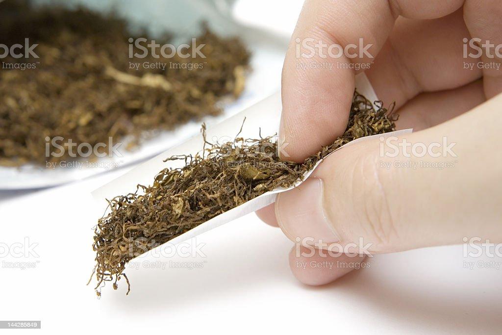 Rolling a Cigarette stock photo