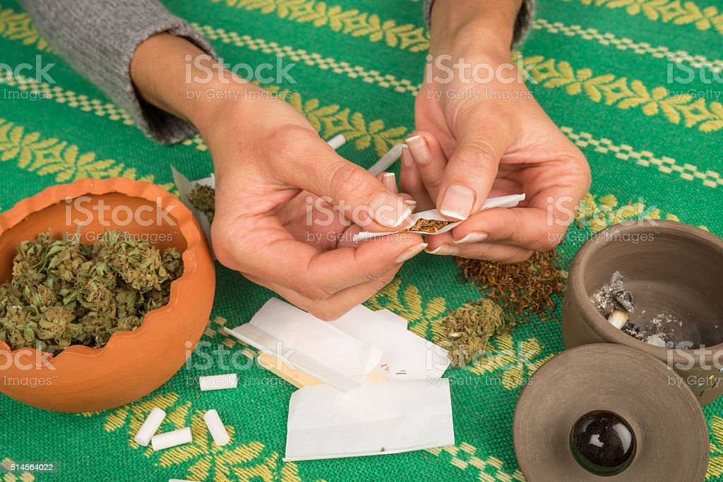 Rolling a joint stock photo