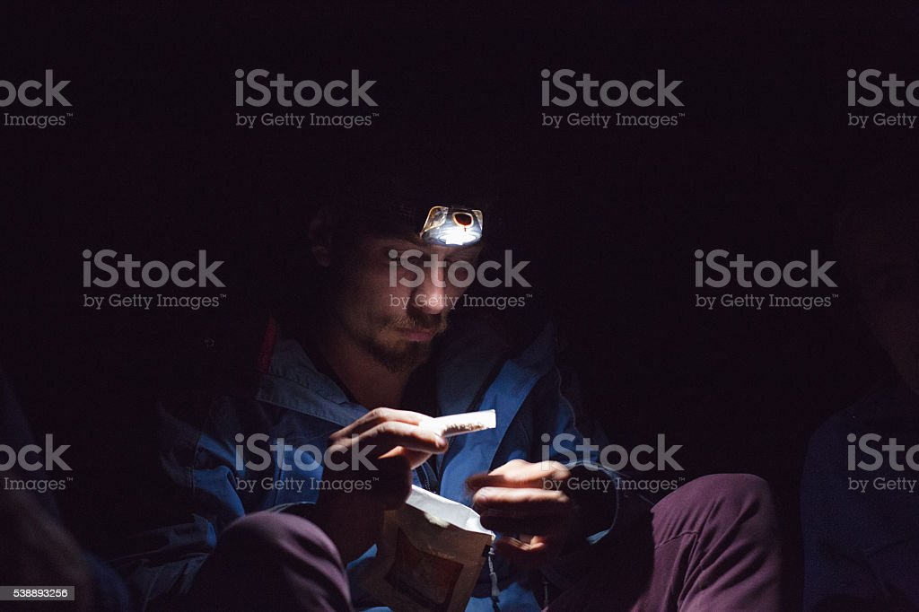 rolling cigarettes on a camping outdoors in a nature stock photo