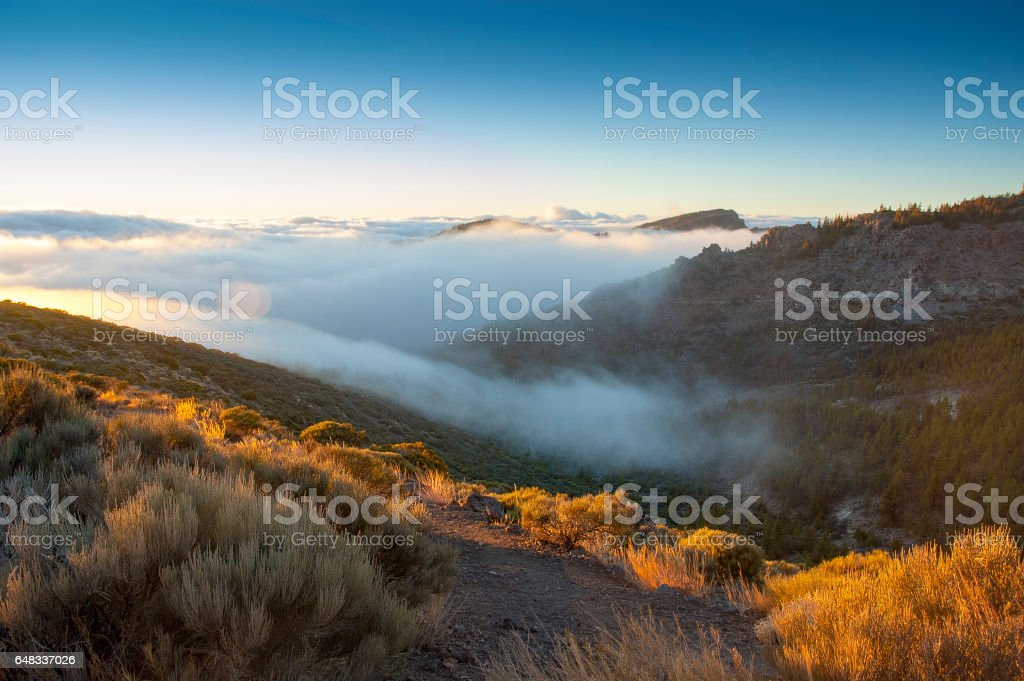 Rolling clouds below Mount Teide in Tenerife stock photo