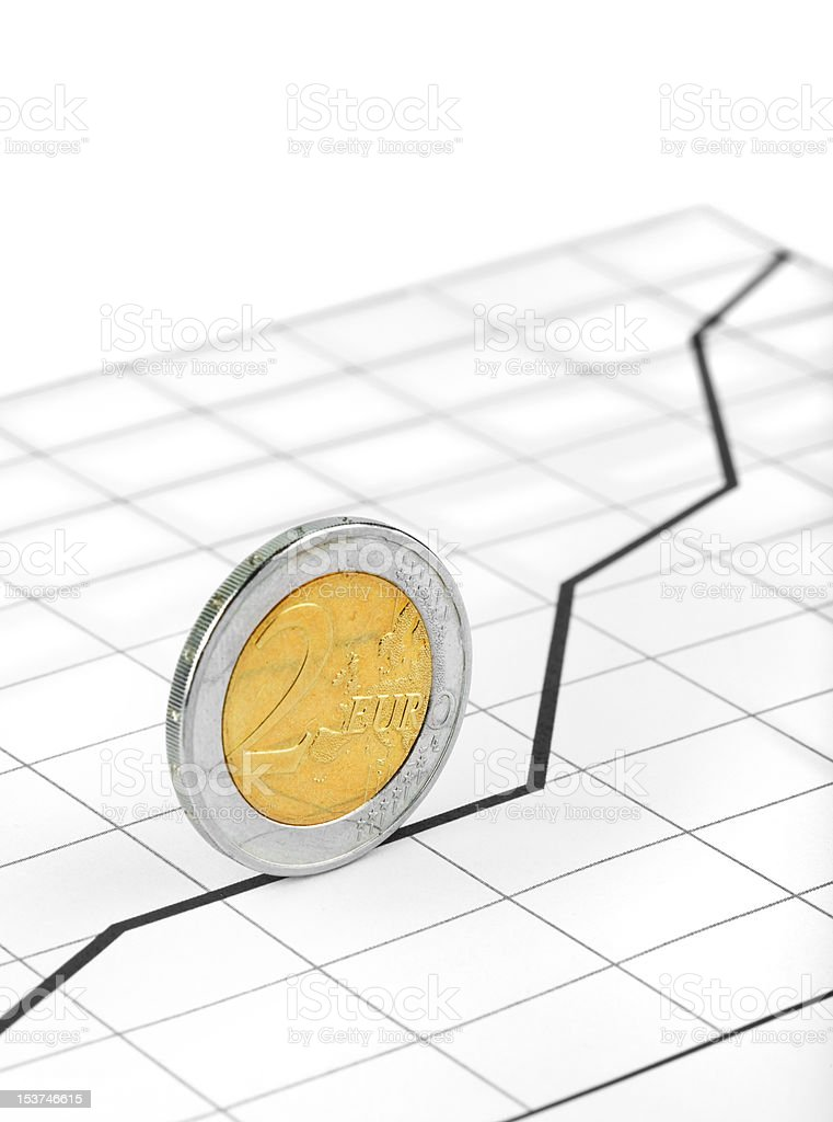 Rolling coin and diagram royalty-free stock photo