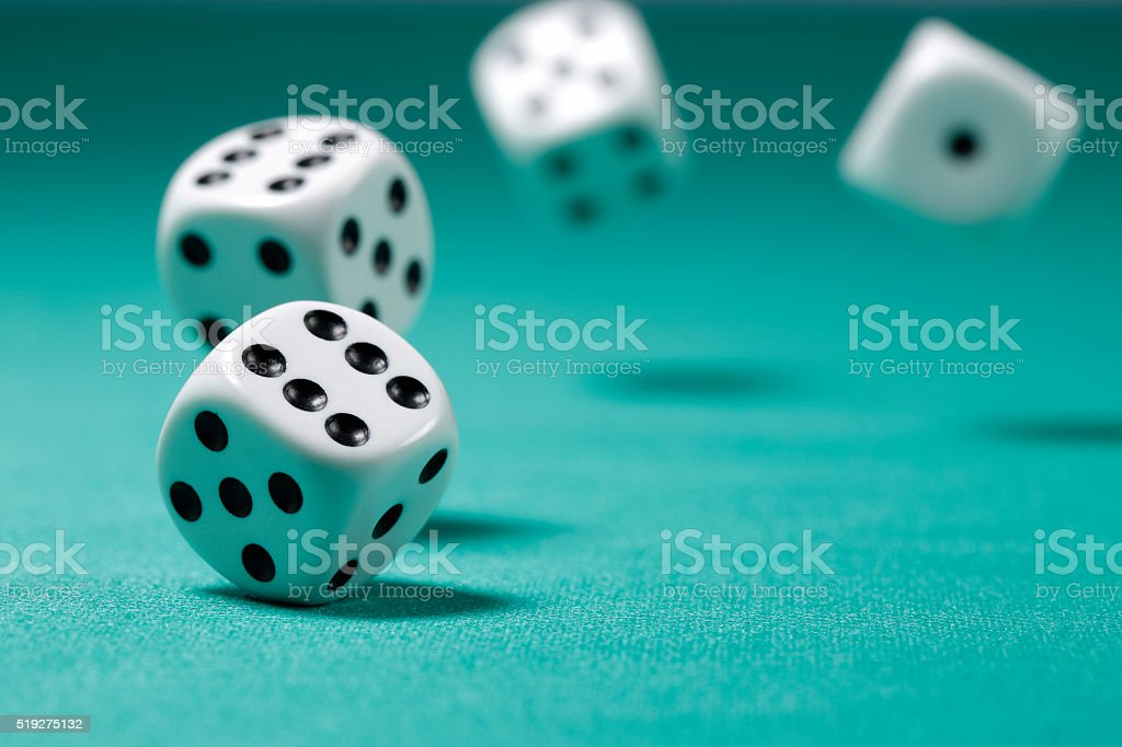 Rolling Dice on Felt Table stock photo