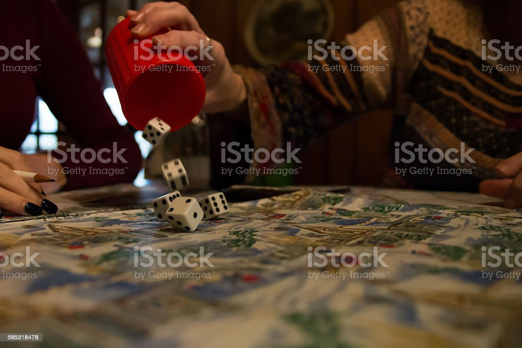 Rolling Dice out of Cup Playing Family Game stock photo