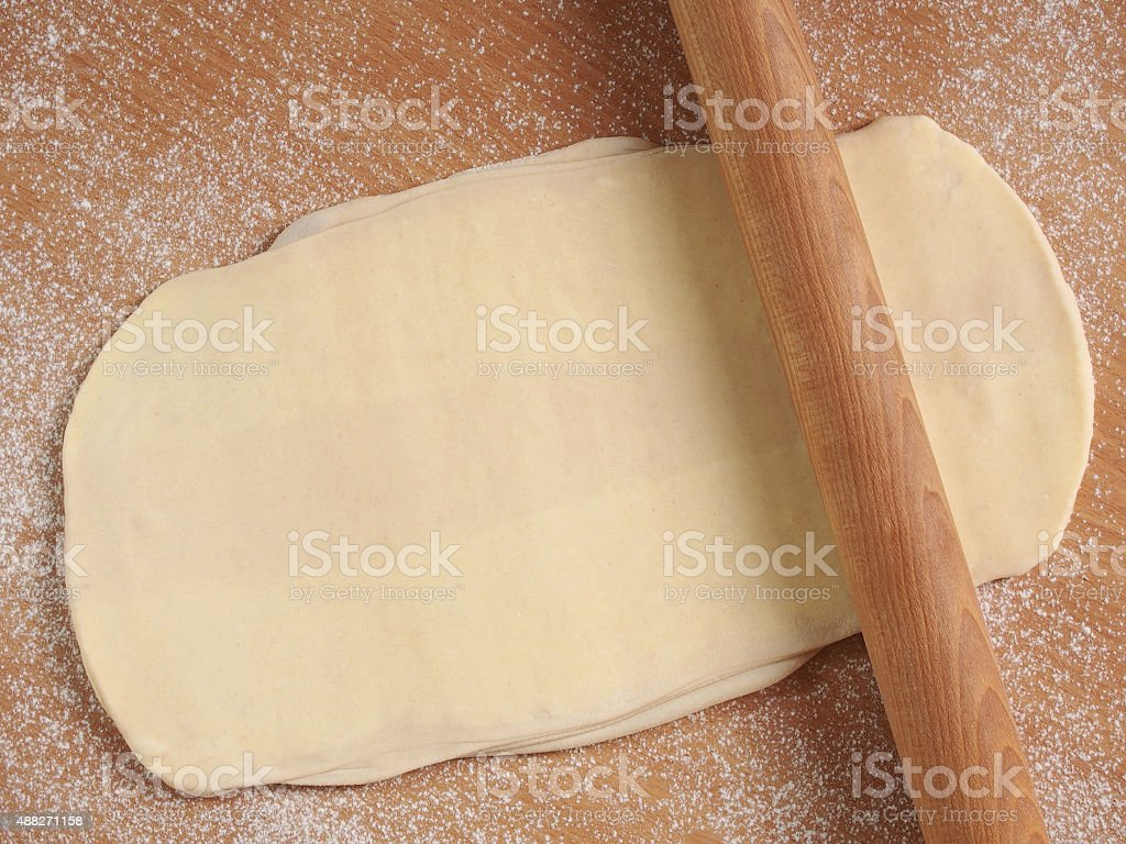 Rolling dough. Making Puff Pastry Series. stock photo