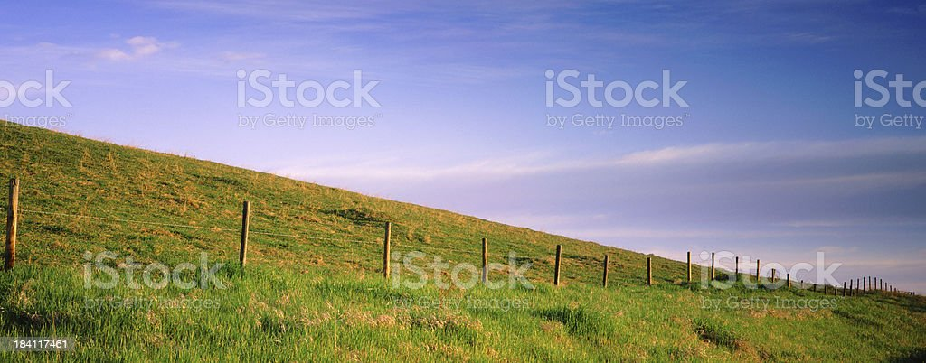 Rolling Fence and Blue sky background stock photo
