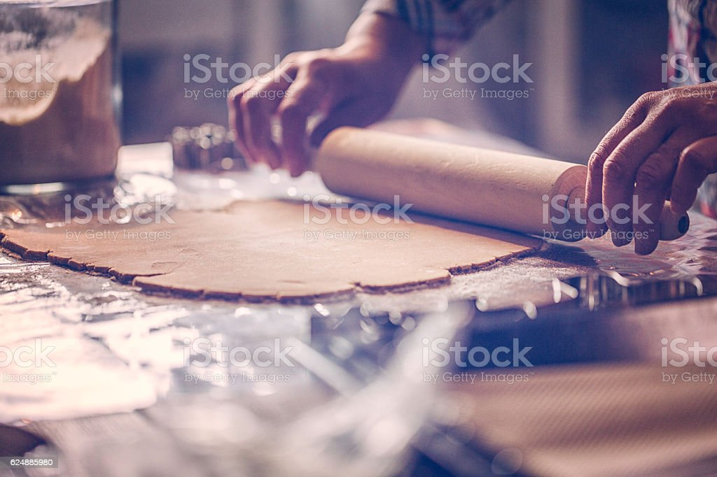 Rolling Gingerbread Dough for Christmas Baking stock photo
