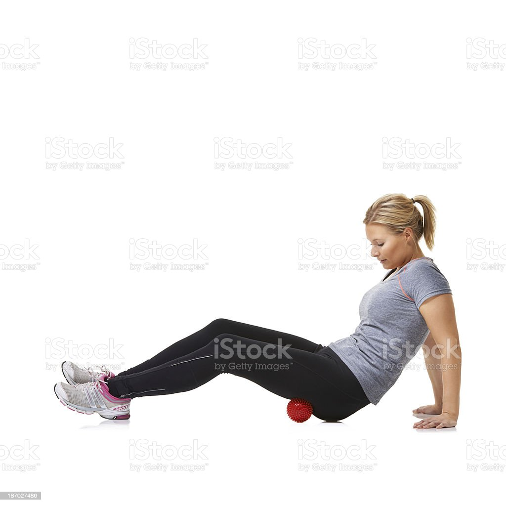 Rolling her glutes stock photo