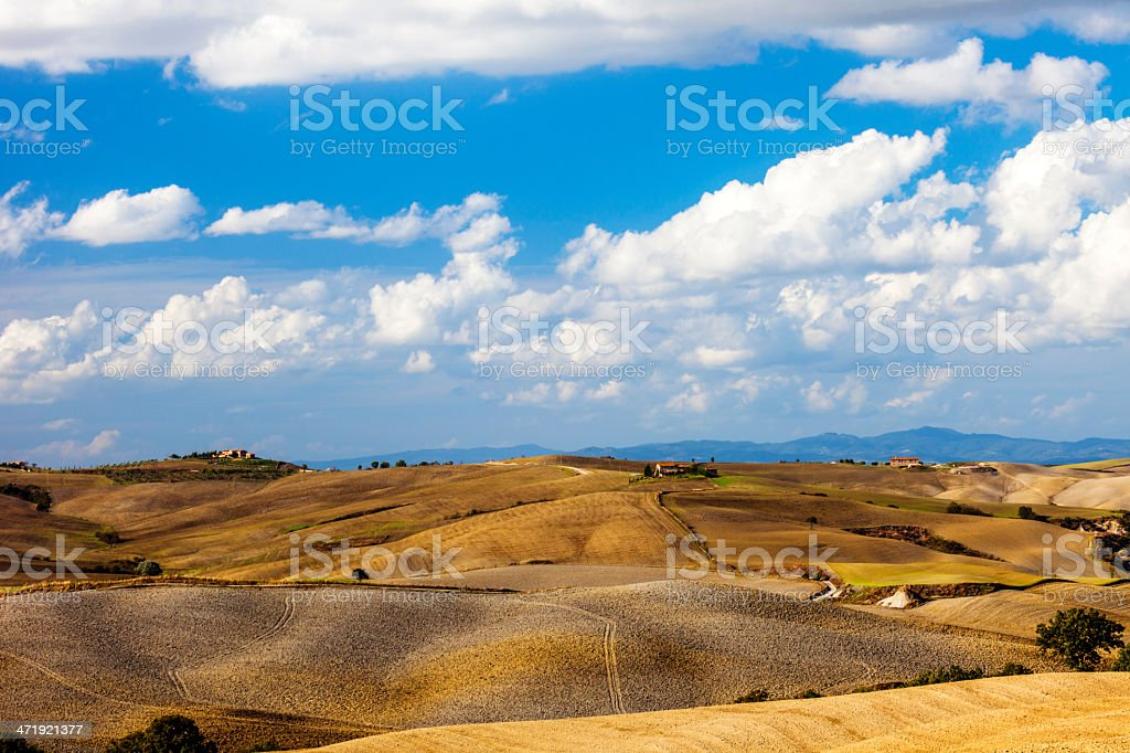 Rolling Hills Under Blue Sky, Tuscany, Italy royalty-free stock photo