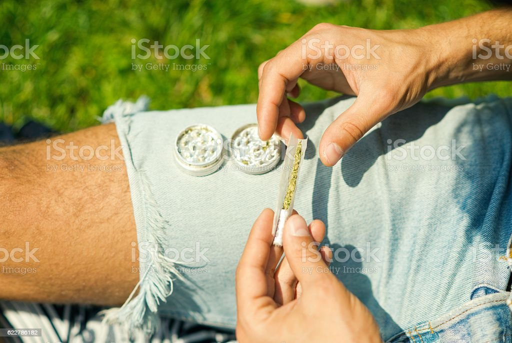 Rolling joint. stock photo