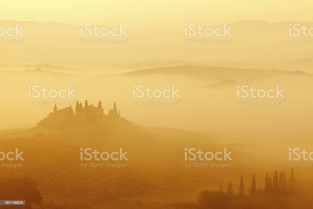 Rolling Landscape at Dawn, Morning Fog, Tuscany, Italy stock photo