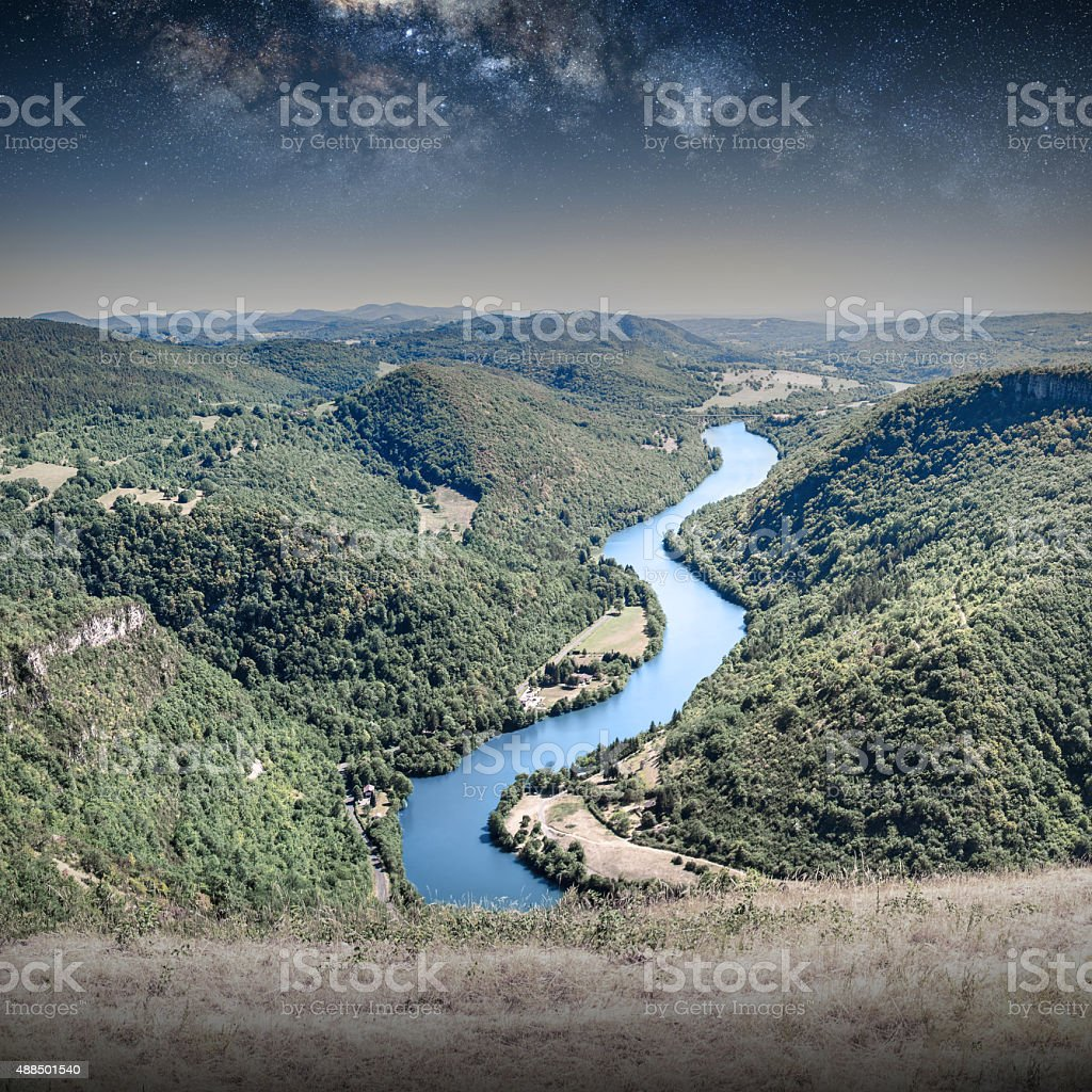 Rolling landscape countryside Ain river by starry sky by night stock photo