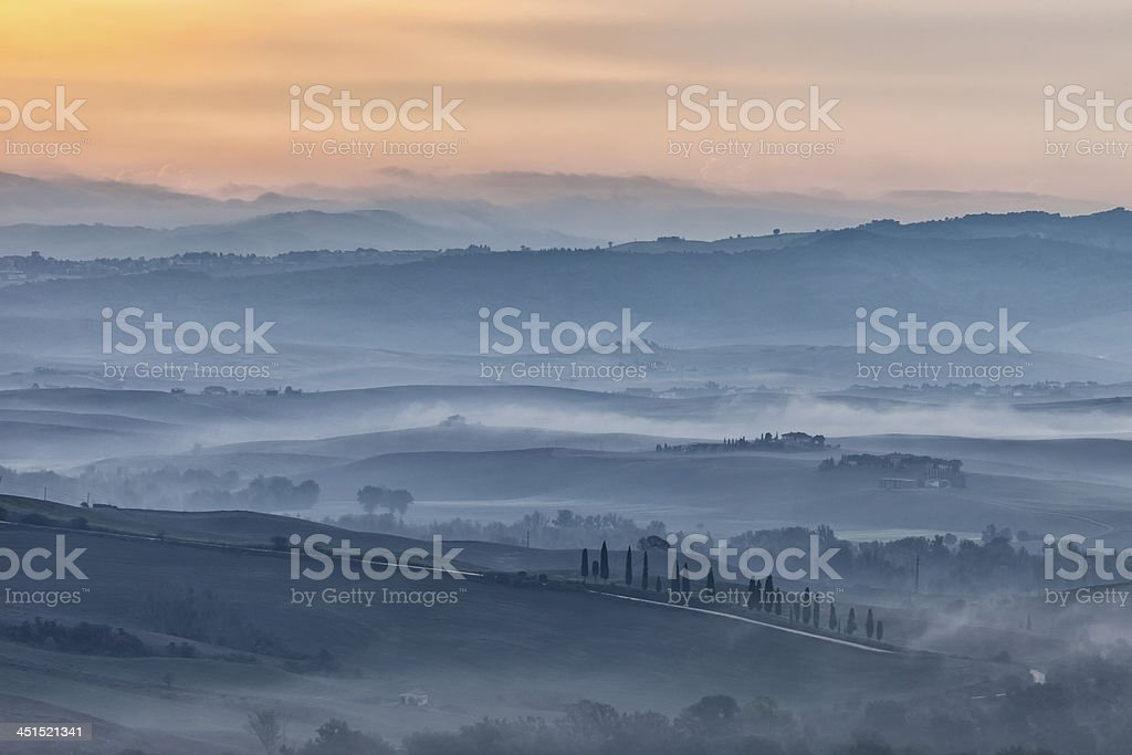 Rolling Landscape With Morning Fog Before Sunrise, Tuscany, Italy royalty-free stock photo