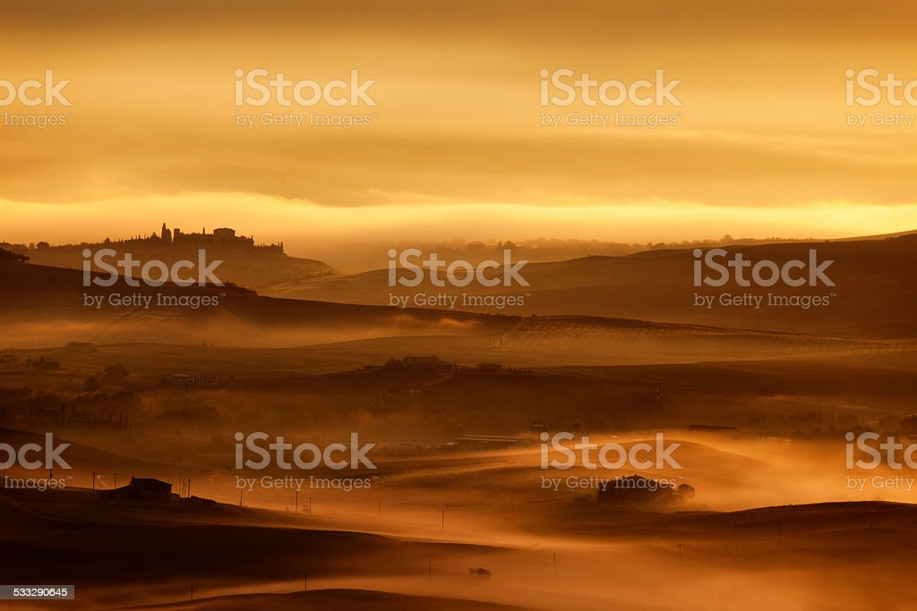 Rolling Landscape With Morning Fog, Tuscany, Italy stock photo