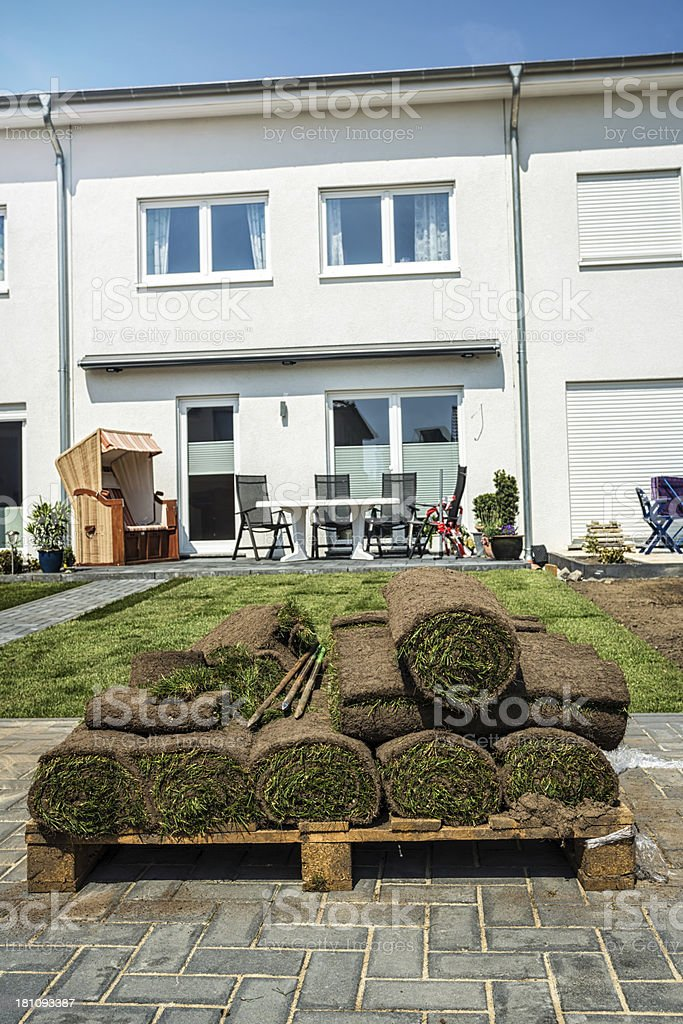 Rolling lawn in front of a new house stock photo