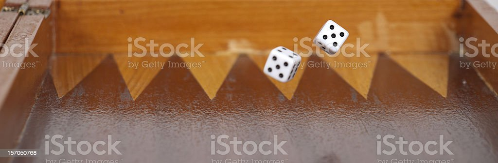 Rolling Lucky Dices On Board royalty-free stock photo