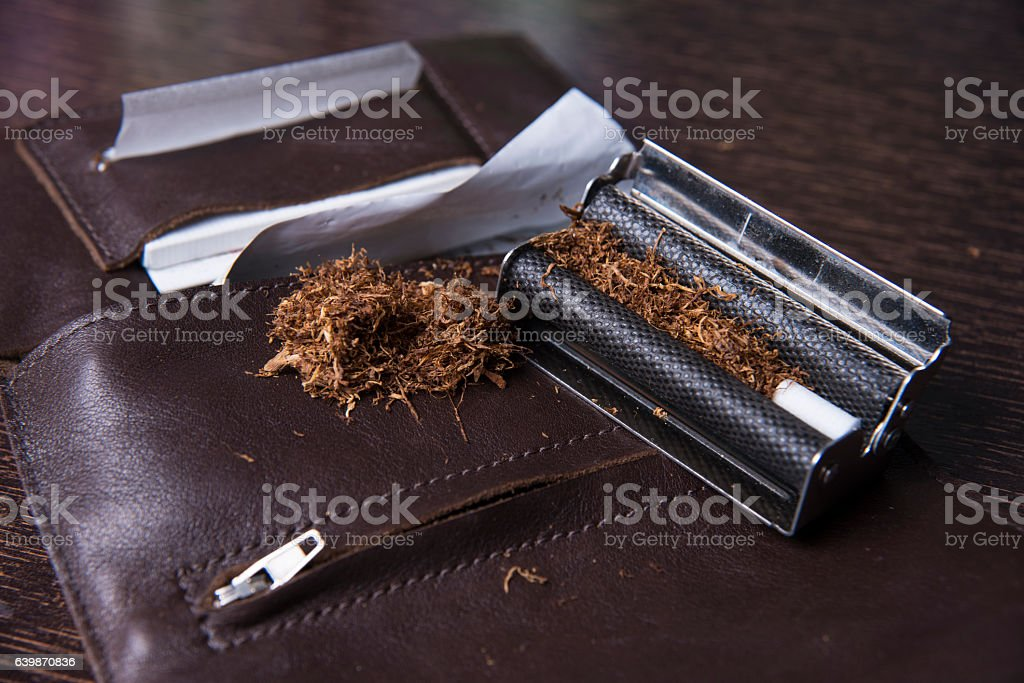 Rolling Machine And Tobacco stock photo
