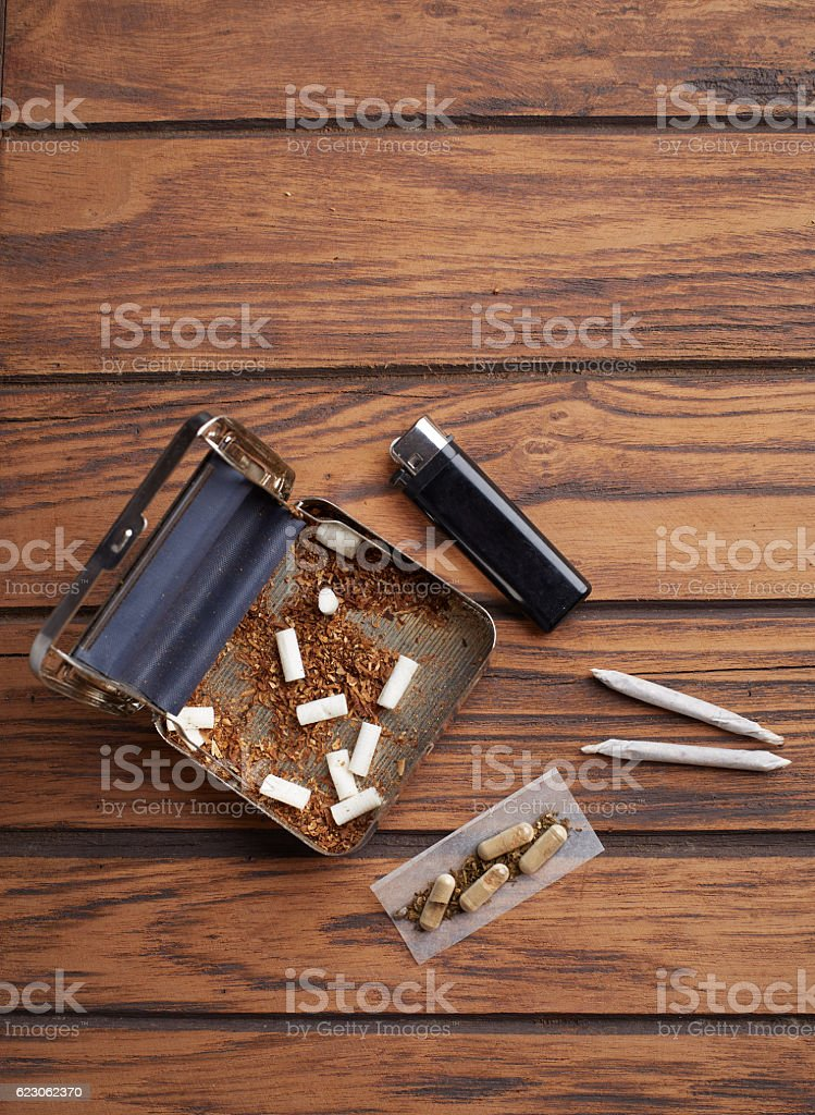 rolling machine with filters marijuana joint and capsule from weeds stock photo