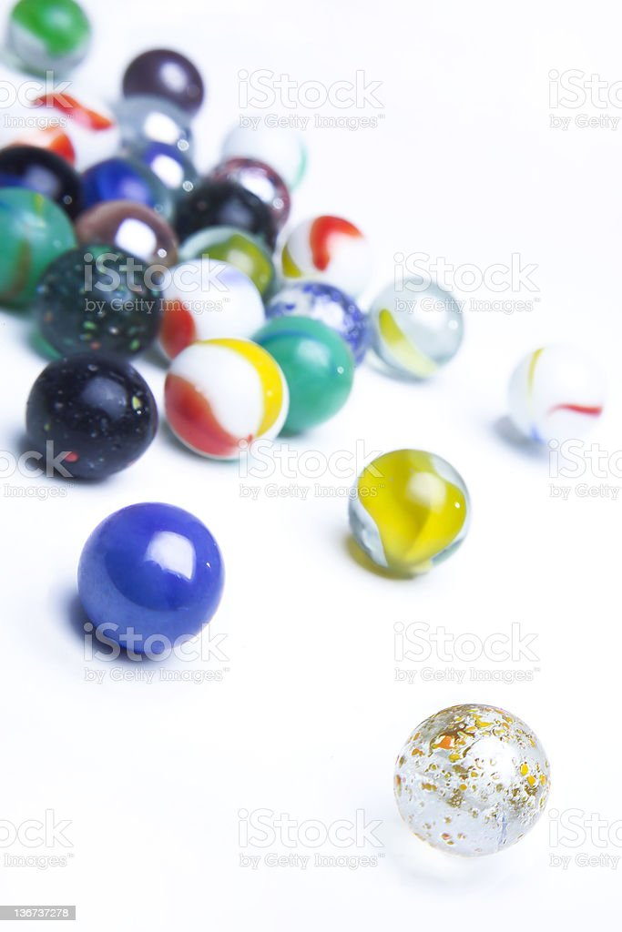 rolling marbles royalty-free stock photo