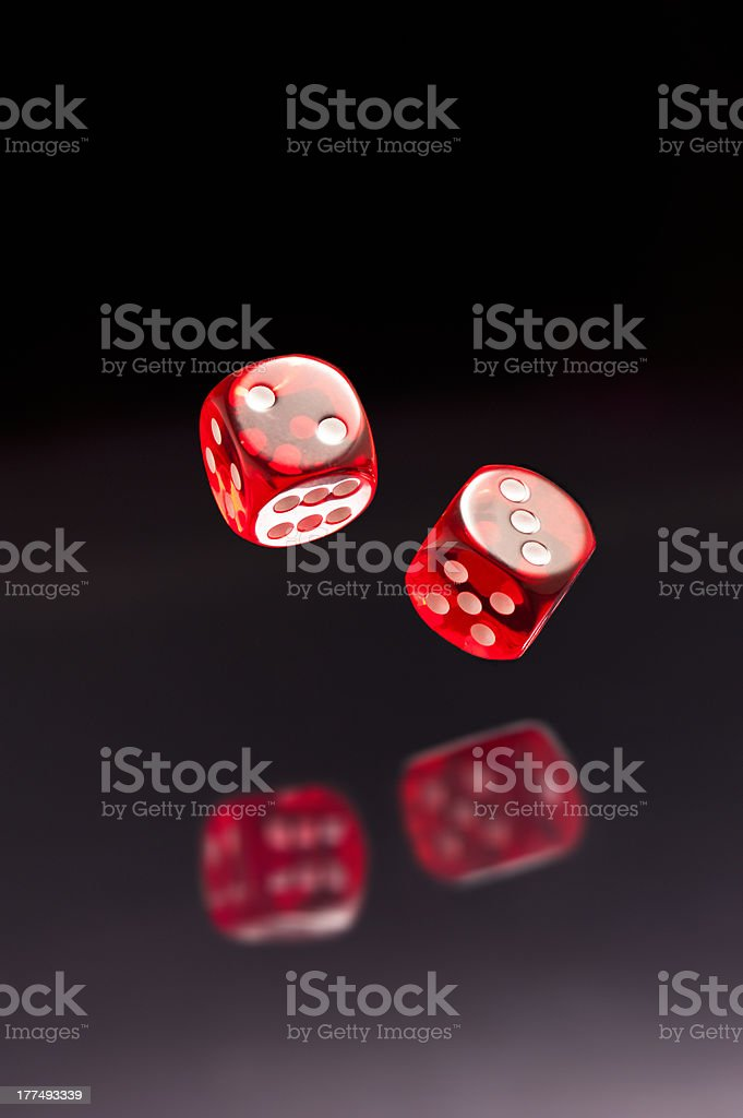Rolling red dice royalty-free stock photo
