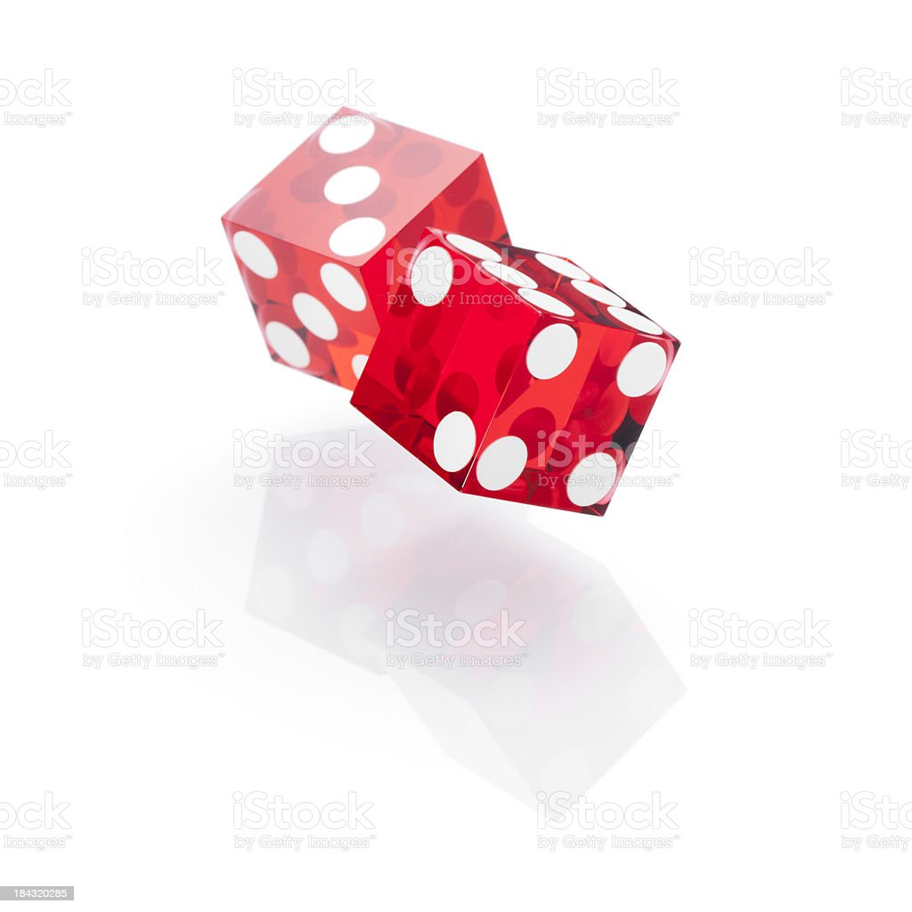 Rolling red dice stock photo