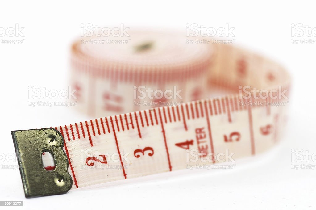 Rolling out measuring tape, on its side royalty-free stock photo