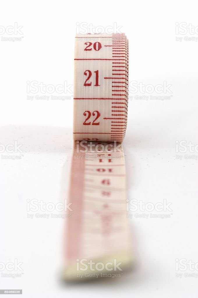 Rolling out measuring tape royalty-free stock photo