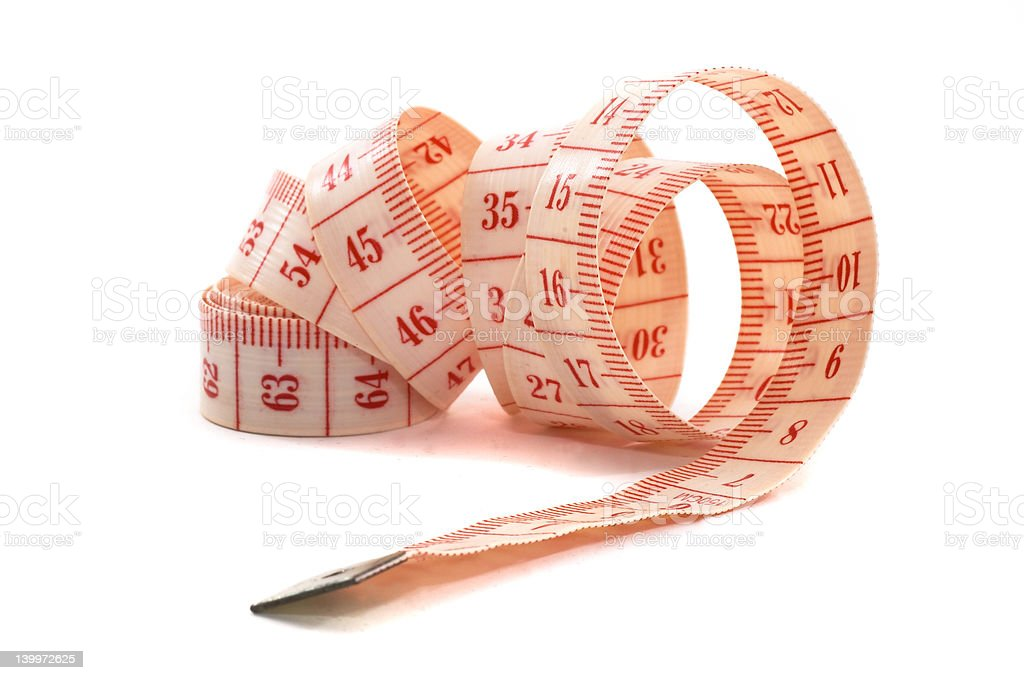 Rolling out measuring tape, unraveling royalty-free stock photo