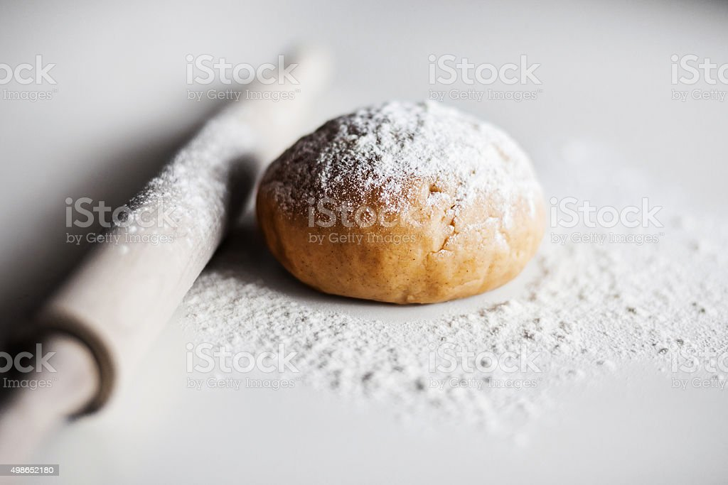 Rolling pin, dough and flour stock photo