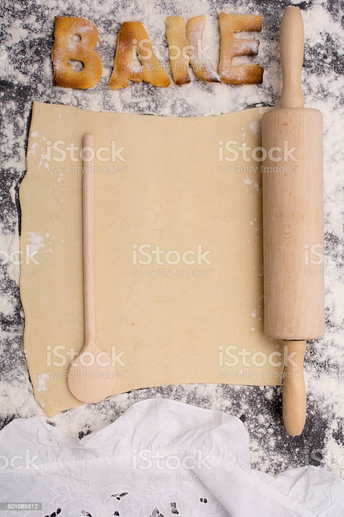 rolling pin with word bake  on black counter stock photo