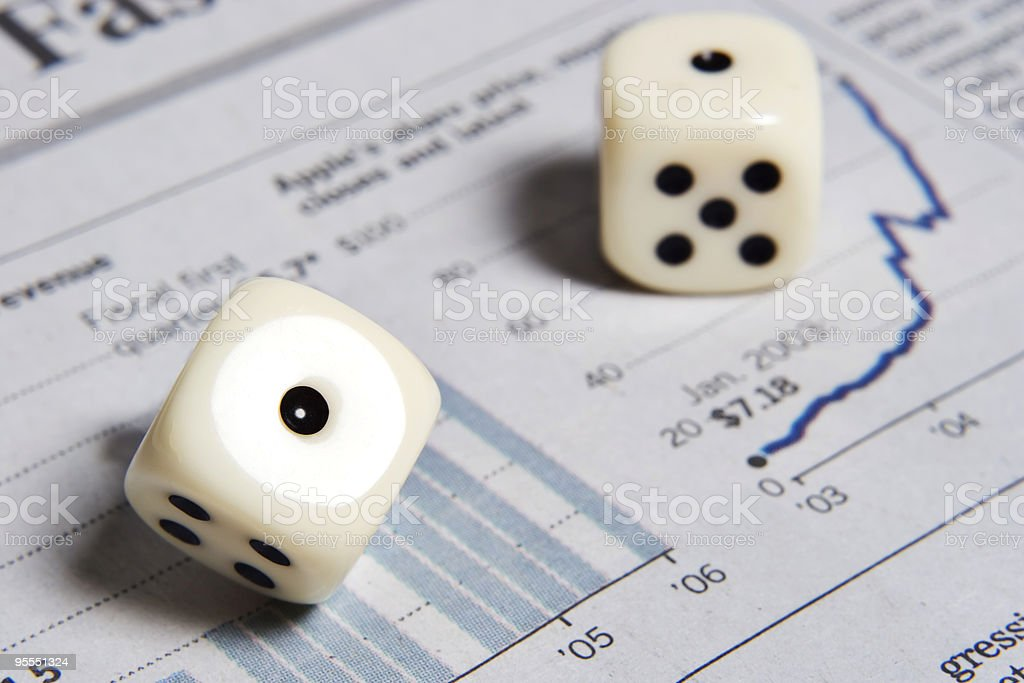 Rolling some dice and having them land on snake eyes royalty-free stock photo