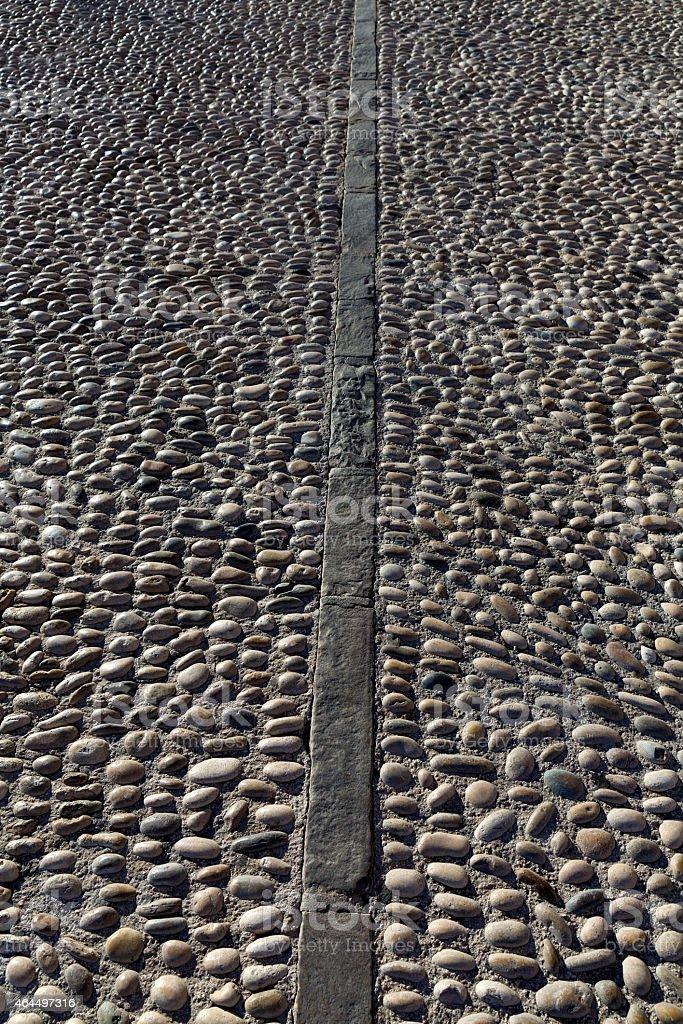 Rolling stones pavement soil texture in Altea Alicante stock photo