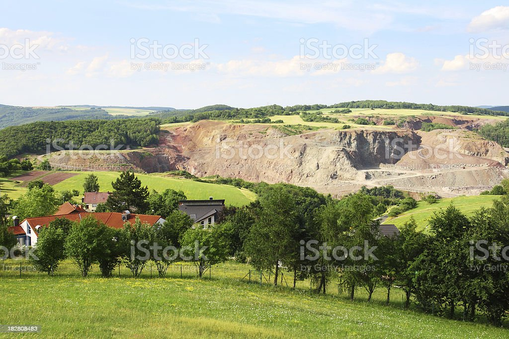 Rolling summer landscape with villages and quarry royalty-free stock photo