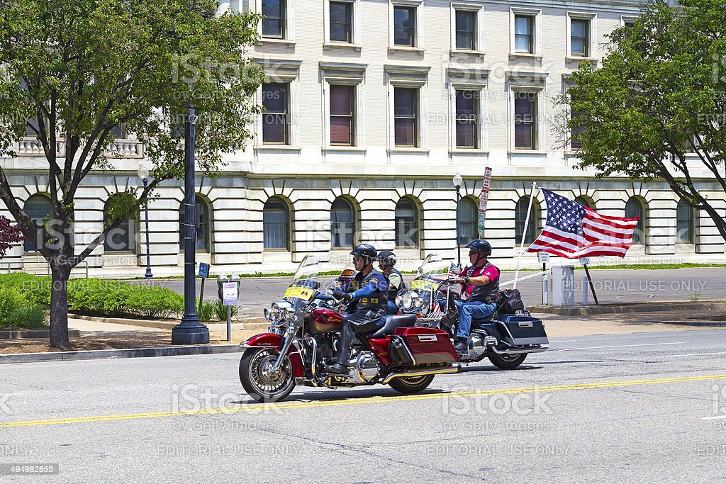 Rolling Thunder rally participants on motorbikes with flags stock photo