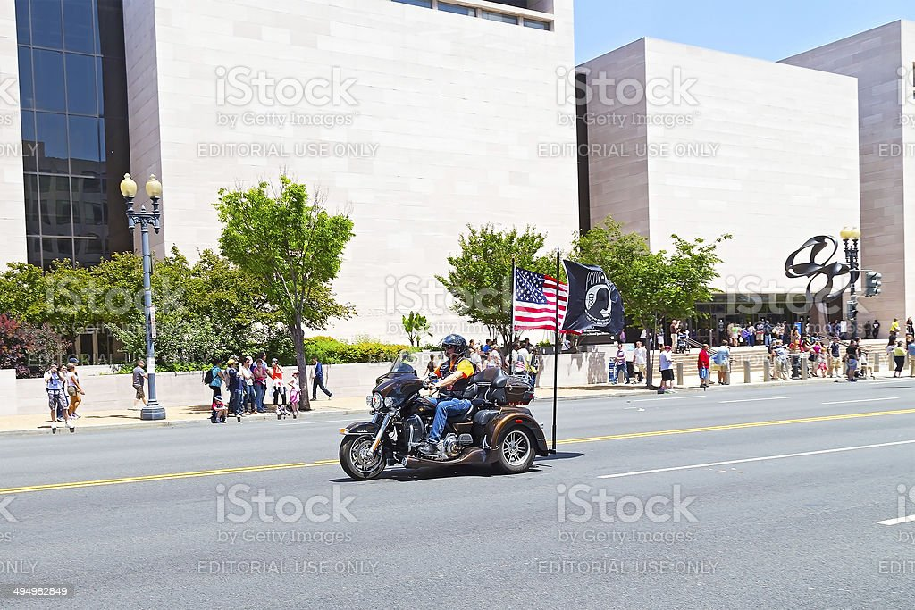 Rolling Thunder ride participant with flags stock photo