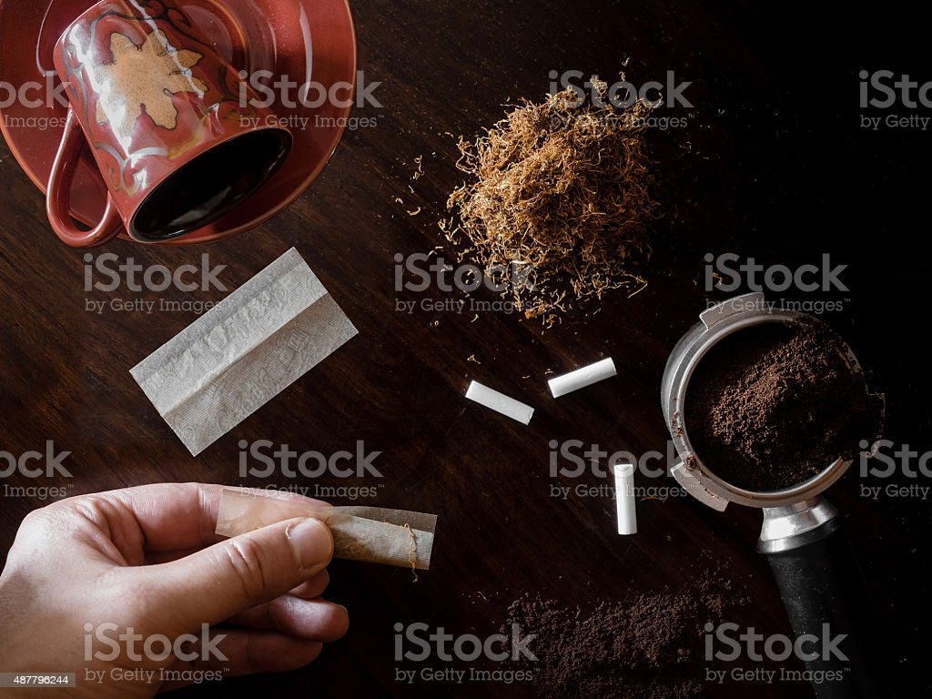 Rolling tobacco and coffee stock photo