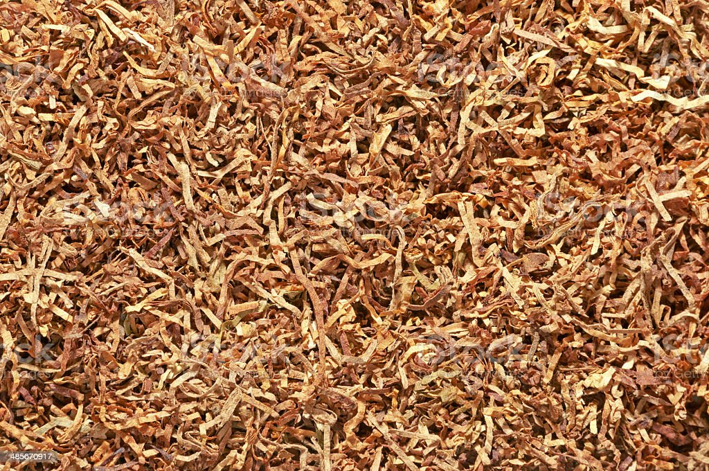rolling tobacco texture stock photo