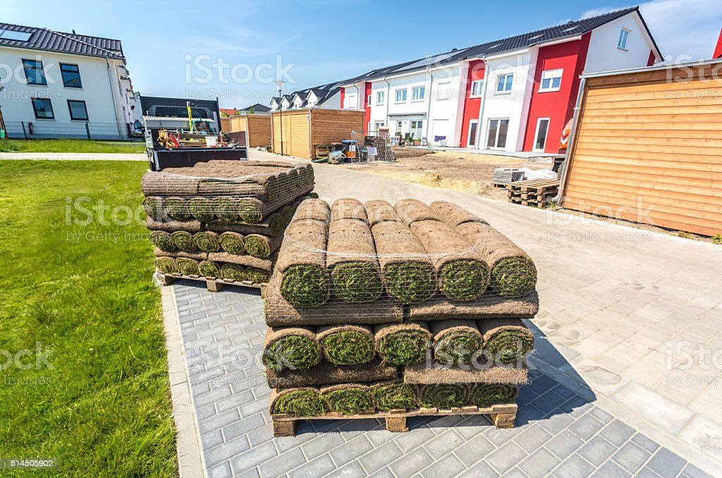 Rolling turf in front of construction side stock photo