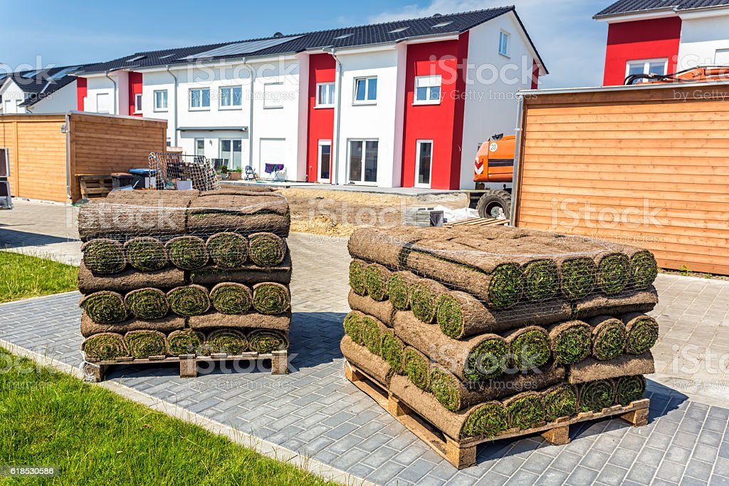 Rolling turf in front of construction site stock photo