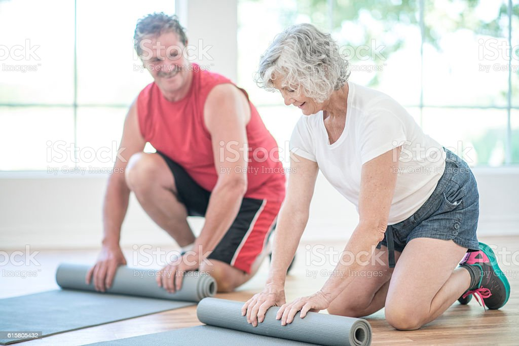 Rolling Up Exercise Mats stock photo