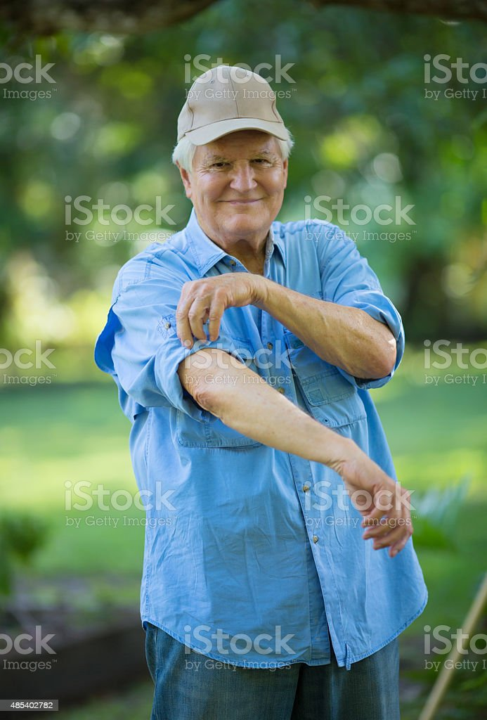 Rolling up his sleeves stock photo