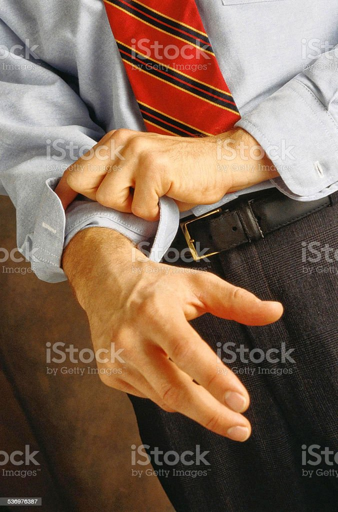 Rolling up Sleeve. stock photo