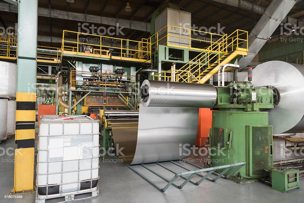 Rolls of aluminium metal in processing plant stock photo