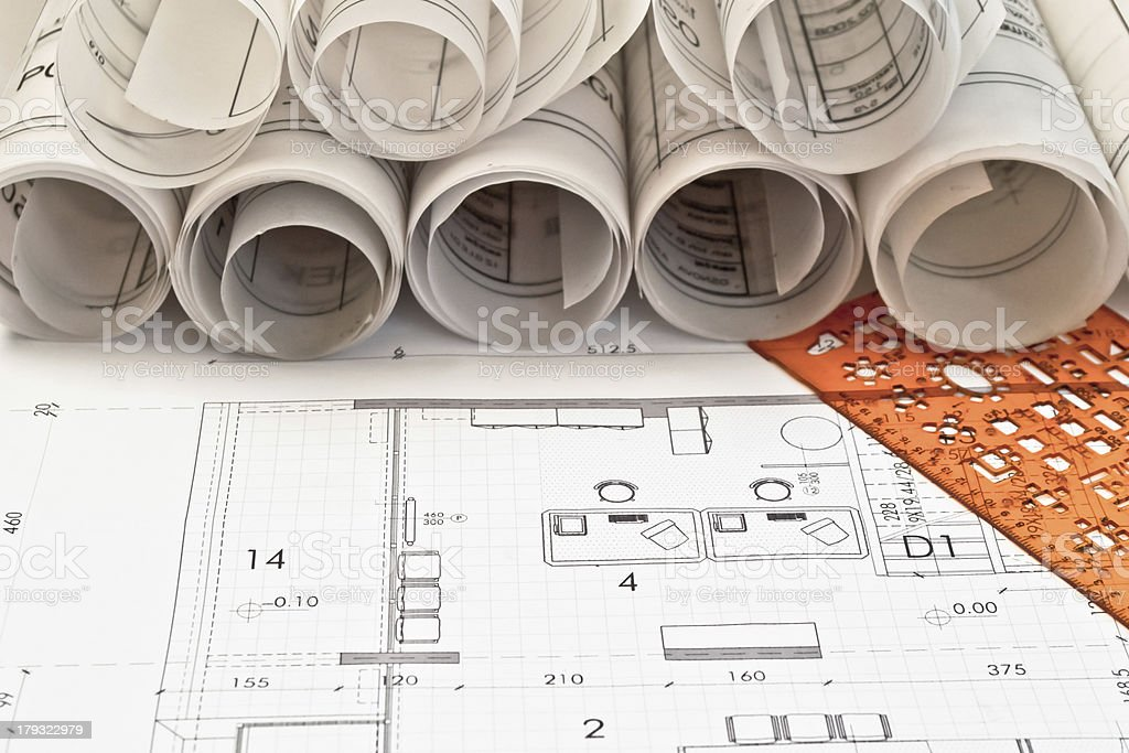 Rolls of architectural designs and blue prints stock photo