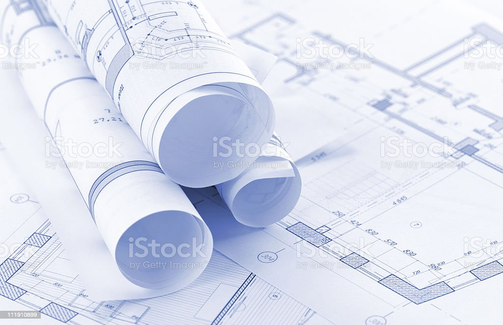 Rolls of architectural drawings royalty-free stock photo