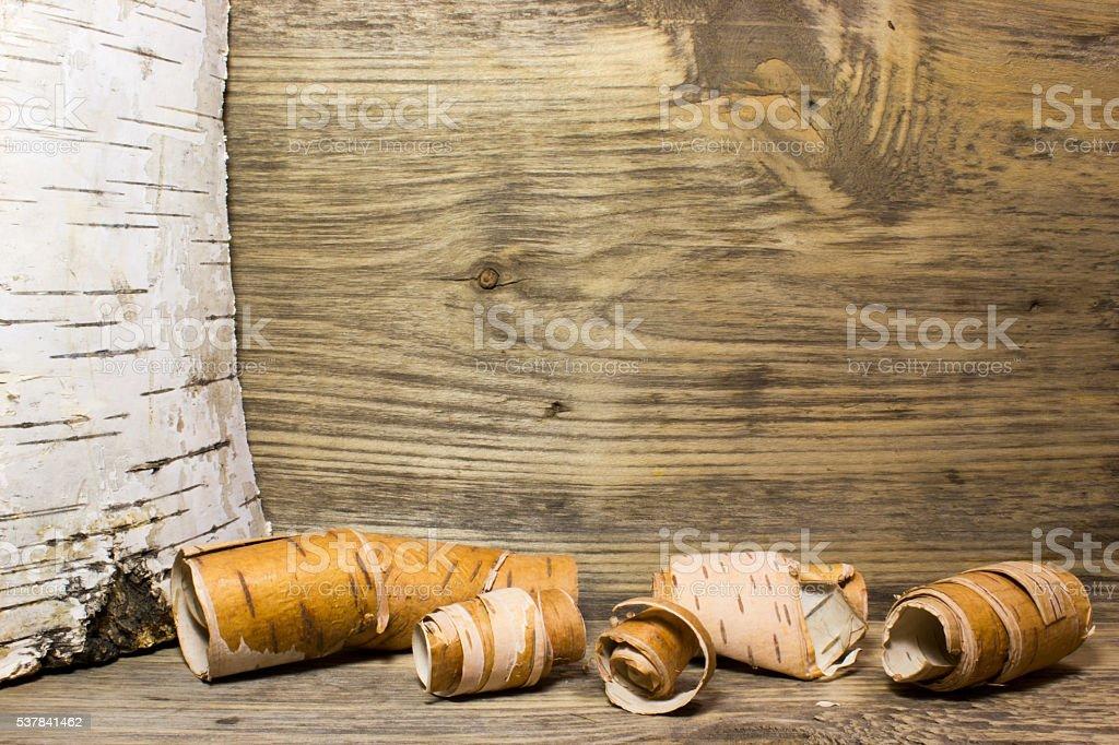Rolls of birch Bark on wooden stock photo